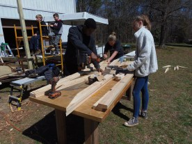 Students putting together the roof truss